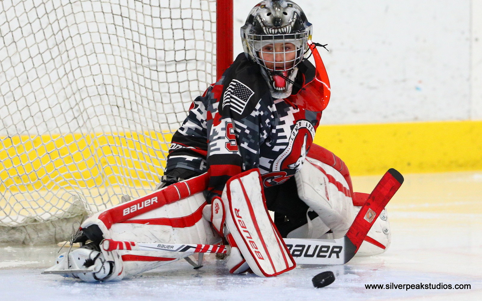 SilverPeak Studios Action Sports Hockey Squirt A Lower Cape Coyotes Goalie Puck Photography